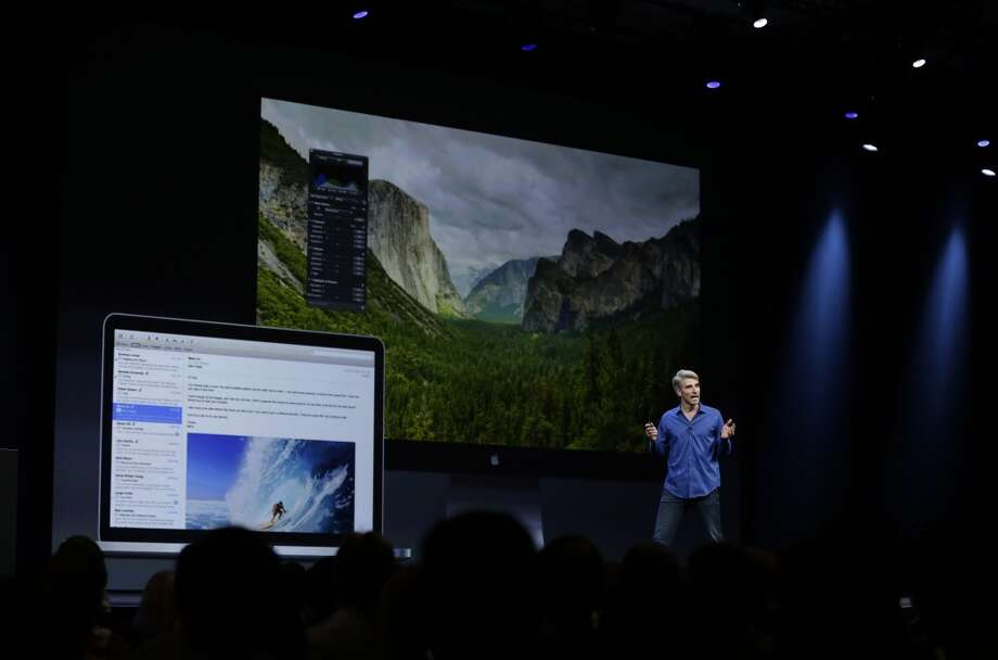 Craig Federighi, senior vice president of software engineering at Apple, introduces the new OS X Mavericks operating system during the keynote address of the Apple Worldwide Developers Conference, Monday, June 10, 2013, in San Francisco.