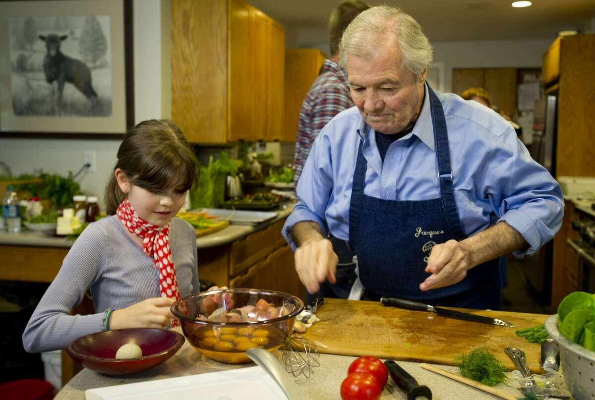"""Chef Jacques Pepin cooks with his granddaughter, Shorey, during a taping of """"Moveable Feast with Fine Cooking"""" for Public Television at Millstone Farms in Wilton, Conn., on Friday, June 7, 2013."""