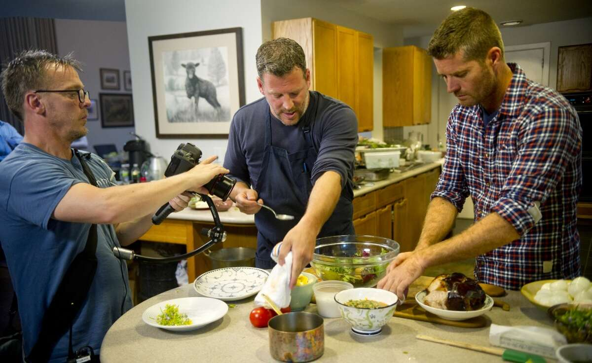 """Chef Bill Taibe, center, cooks during a taping of """"Moveable Feast with Fine Cooking"""" for Public Television at Millstone Farms in Wilton, Conn., on Friday, June 7, 2013."""