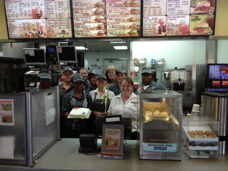 Emplyees of the Jasper Burger King showing their award and pride in winning it over 31 other restuarants. by submission