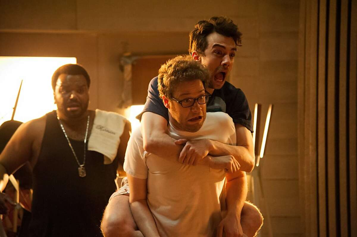"""L-r, Craig Robinson, Seth Rogen and Jay Baruchel in Columbia Pictures' """"This Is the End""""."""