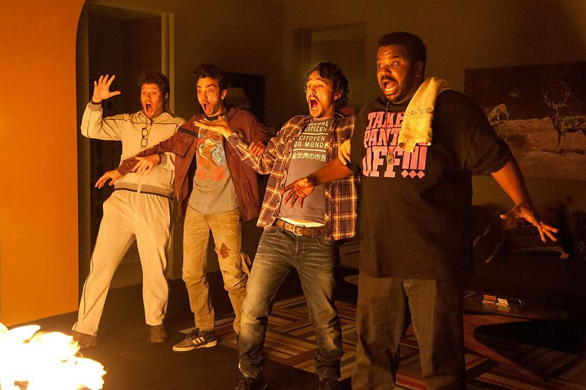 """L-r, Seth Rogen, Jay Baruchel, James Franco and Craig Robinson in Columbia Pictures' """"This Is the End""""."""