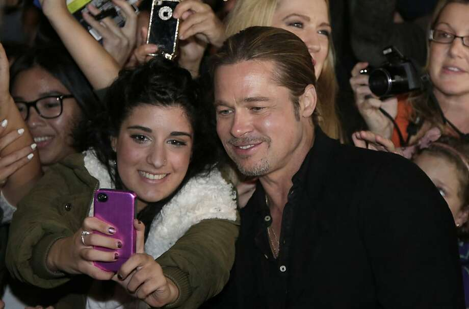 "A dream comes truefor a fan of Brad Pitt with a smartphone at the Australian premiere of ""World War Z"" in Sydney. Photo: Rob Griffith, Associated Press"