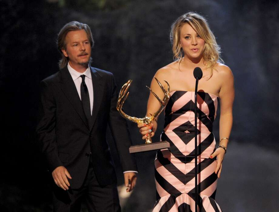 CULVER CITY, CA - JUNE 08:  Actors David Spade presents an award to Kaley Cuoco onstage during Spike TV's Guys Choice 2013 at Sony Pictures Studios on June 8, 2013 in Culver City, California.  (Photo by Kevin Winter/Getty Images for Spike TV)