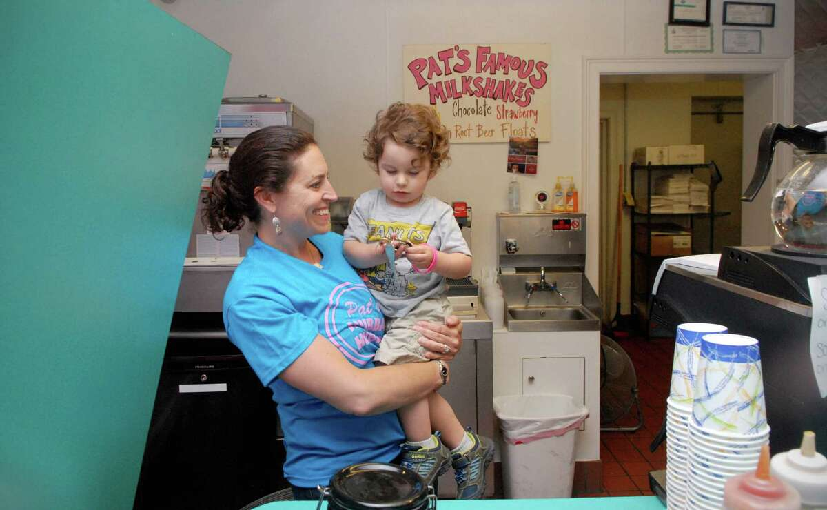 Chrissie Rodreguez hold her son Michael (2) at Pat's Hubba Hubba restaurant in Stamford, Conn. on Monday June 10, 2013.