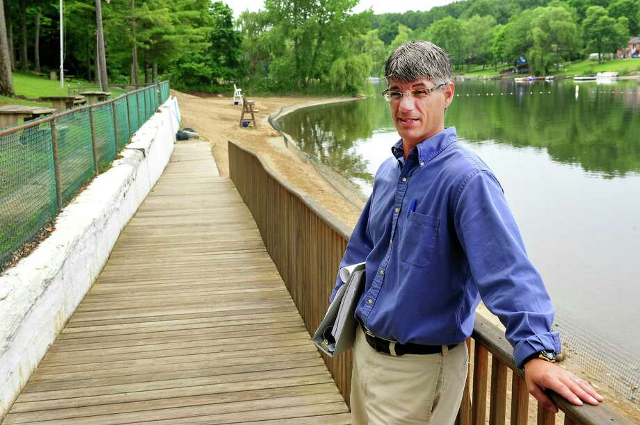 Parks and Recreation Director Dennis DiPinto talks about the revitalization project Brookfield, Conn., is considering for the Brookfield Town Beach and Cadigan Park Monday, June 10, 2013. Photo: Michael Duffy / The News-Times