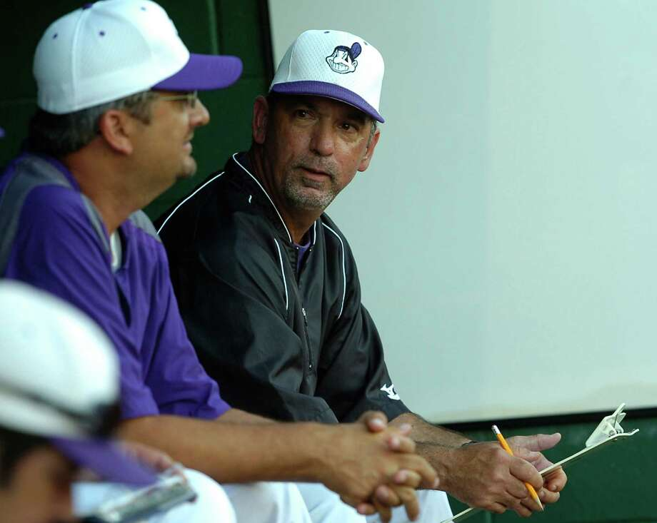 Indian Head Coach Mark Brevell, right, discusses strategy with his assistants.  The Port Neches-Groves baseball team played Baytown Lee Wednesday night, May 2, 2012, at Vincent Beck Stadium on the Lamar University campus.  Dave Ryan/The Enterprise Photo: Dave Ryan