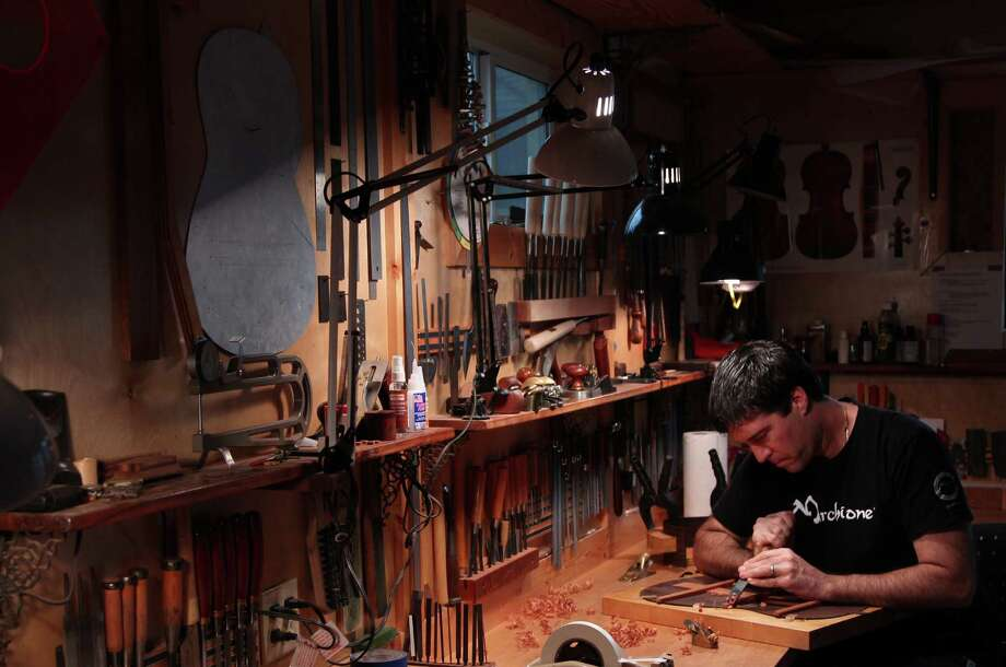 Stephen Marchione, Houston-based guitar maker, works on a rosewood back and sides of a classical guitar in his Montrose studio on Monday, Feb. 11, 2013, in Houston. ( Mayra Beltran / Houston Chronicle ) Photo: Mayra Beltran, Staff / © 2013 Houston Chronicle
