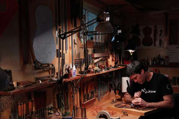 Stephen Marchione, Houston-based guitar maker, works on a rosewood back and sides of a classical guitar in his Montrose studio on Monday, Feb. 11, 2013, in Houston. ( Mayra Beltran / Houston Chronicle )
