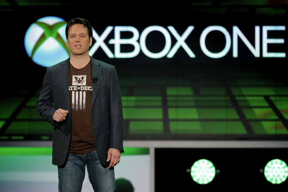Phil Spencer of Microsoft Game Studios speaks at the Microsoft Xbox E3 media briefing in Los Angeles, Monday, June 10, 2013. Microsoft focused on how cloud computing will make games for its next-generation Xbox One console more immersive during its Monday presentation at the Electronic Entertainment Expo. Microsoft announced last week that the console must be connected to the Internet every 24 hours to operate, and the system would ideally always be online. (AP Photo/Jae C. Hong) Photo: Jae C. Hong, STF / AP