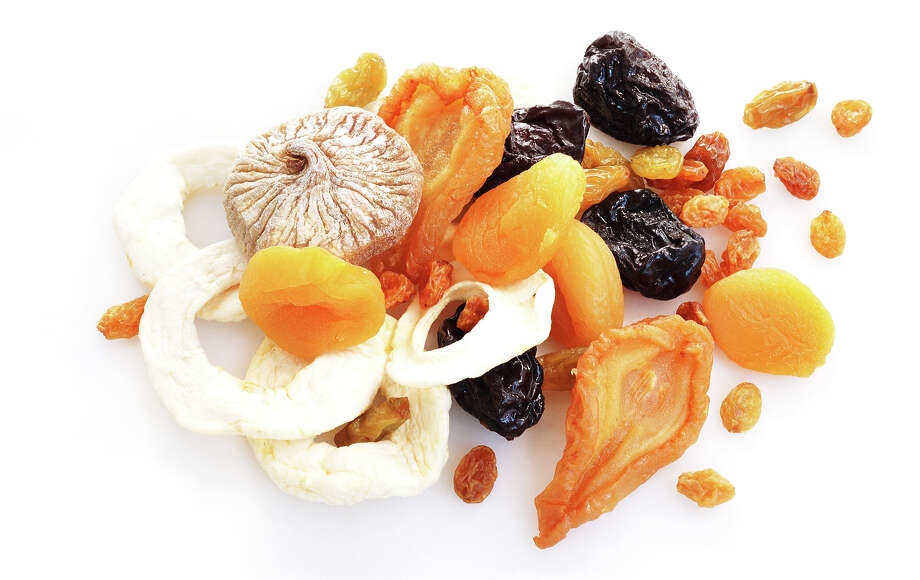 Dried Fruit:This common snack can be highly caloric.  When fruit is dried, there is less water so sugar becomes more dense —  like grapes dried into raisins. Portions should be limited to a quarter  of a cup. Photo: Michael Rosenfeld, Getty / (c) Michael Rosenfeld