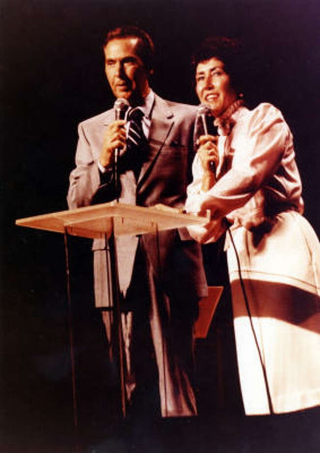 Pastors John and Dodie Osteen leading a service together. Decades later, Joel and Victoria Osteen address the congregation together just like his parents once did. Photo: Provided By Lakewood Church