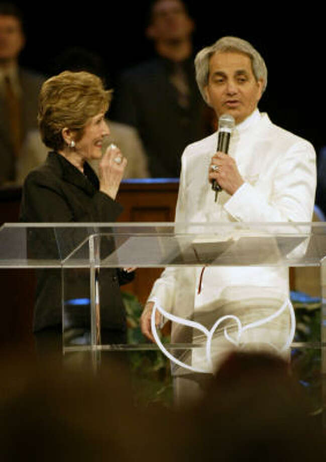 Dodie Osteen is welcomed to share the stage with evangelist Benny Hinn during his service at the Toyota Center on Feb. 24, 2005. Photo: Kevin Fujii, Houston Chronicle