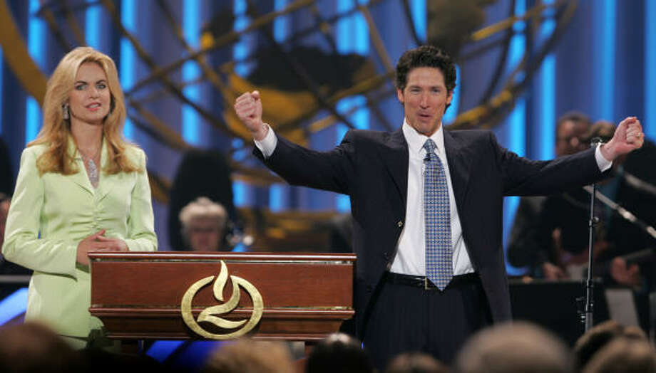 Joel Osteen, right, and his wife, Victoria, welcome the overflow crowd to the opening services of Lakewood Church Saturday, July 16, 2005, in Houston. Lakewood Church converted the Compaq Center, the former home of the Houston Rockets, into one of the largest churches in the country. Photo: BRETT COOMER, HOUSTON CHRONICLE