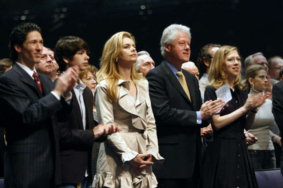 Joel and Victoria Osteen, pastors of Lakewood Church, with their son, Jonathan Osteen (age 13) between them, stand alongside former President Bill Clinton (second right) and his daughter, Chelsea Clinton (far right), as they attend early services at Lakewood Church on March 2, 2008. The Clintons were introduced and Pastor Joel Osteen prayed for them and Sen. Hillary Clinton (not in attendance) on Sunday, March 2, 2008. Photo: Steve Ueckert, Houston Chronicle