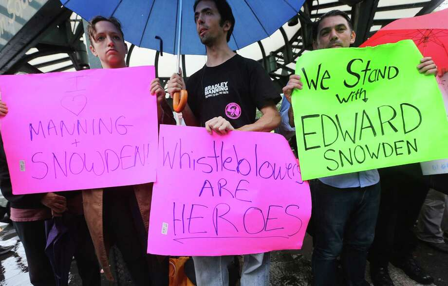 NEW YORK, NY - JUNE 10:  Supporters gather at a small rally in support of National Security Administration (NSA) whistleblower Edward Snowden in Manhattan's Union Square on June 10, 2013 in New York City. About 15 supporters attended the rally a day after Snowden's identity was revealed in the leak of the existence of NSA data mining operations.  (Photo by Mario Tama/Getty Images) Photo: Mario Tama, Staff / 2013 Getty Images