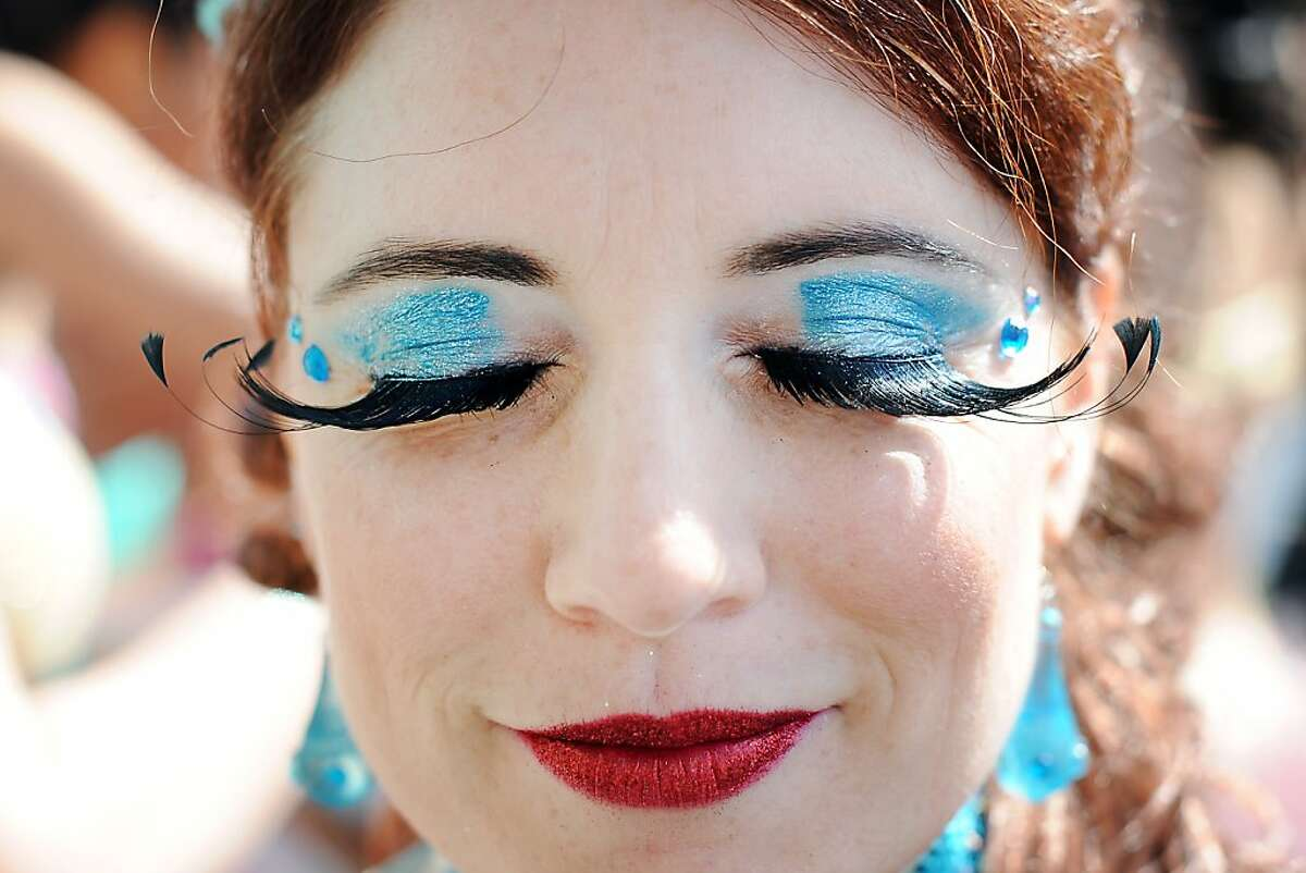 Jamie Hanson with the Hot Pink Feathers group shows off her fancy lashes during the 35th annual Carnaval parade in the Mission District of San Francisco,CA on Sunday May 26th, 2013.