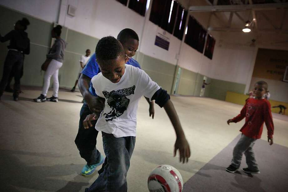 Tyler Henry (front) and Jordan Tucker scramble for the ball in the gym at the Continentals of Omega Boys & Girls Club, which Vallejo residents decided to shower with $60,000 in public funds in a recent citywide vote. Photo: Lea Suzuki, The Chronicle