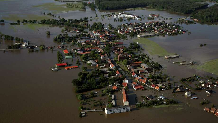 An aerial view of the flooded Fischbeck, near Stendal, eastern Germany, on June 10, 2013. German Chancellor Angela Merkel praised rescue efforts on her third trip to water-logged regions Monday as central Europe grappled with historic floods that have killed at least 19 people. AFP PHOTO / RONNY HARTMANNRONNY HARTMANN/AFP/Getty Images Photo: RONNY HARTMANN, AFP/Getty Images / AFP