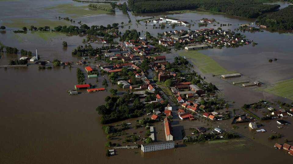 An aerial view of the flooded Fischbeck, near Stendal, eastern Germany, on June 10, 2013. German Cha