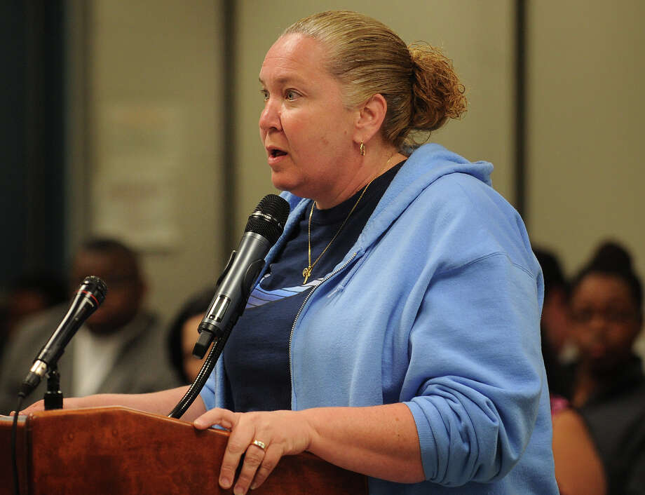 Marylee Taylor, P.A.C. president at Black Rock Elementary School, speaks against the  layoffs of Parent Center coordinator Lisa Pavlich and facilitator Dolores Mason at the Board of Education meeting at the Aquaculture School in Bridgeport, Conn. on Monday, June 10, 2013. Photo: Brian A. Pounds / Connecticut Post