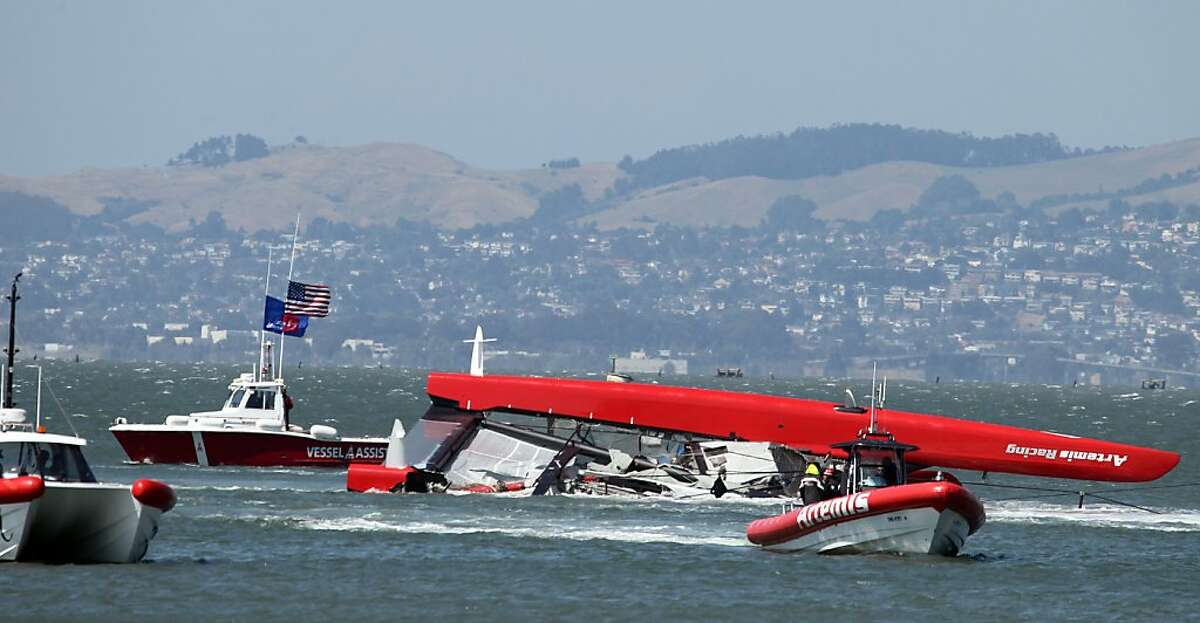 Artemis support boats pull the 72-foot long catamaran that capsized in San Francisco Bay back to the Swedish teams port on Treasure Island Thursday May 9, 2013. The accident killed one crewmember and injured others under the Golden Gate Bridge.