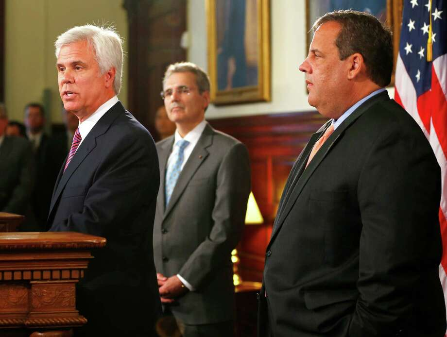 On Monday in Trenton, N.J., Dr. Ronald DePinho, M.D. Anderson's president, center, attends a news conference with George Norcross III, left, chairman of the board of Cooper Health System and N.J. Gov. Chris Christie. Photo: Rich Schultz, FRE / FR27227 AP
