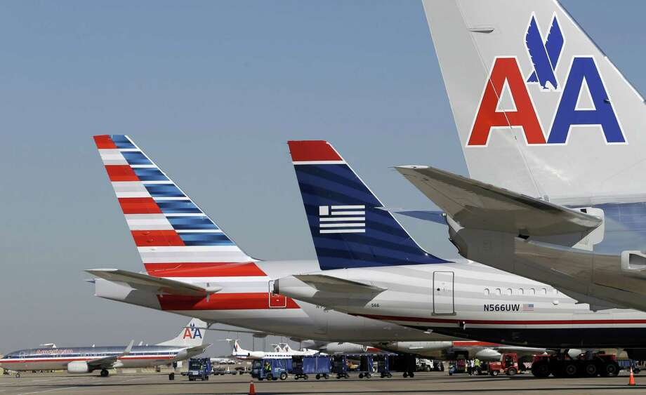 Seven top American Airlines executives will leave the combined American and US Airways. Photo: LM Otero, STF / AP