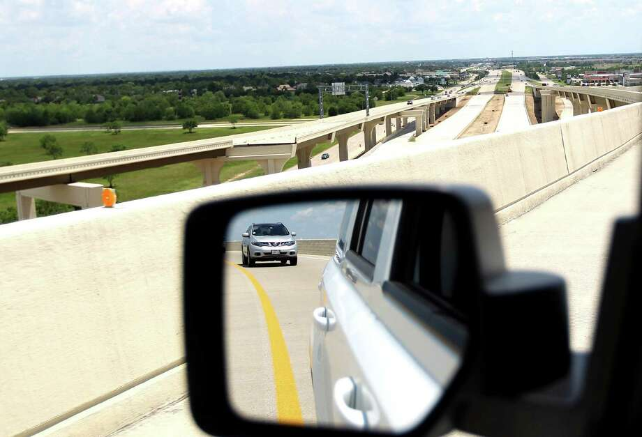 A new overpass from  I-10 to the Grand Parkway has opened near Cinco Ranch in Katy, where city officials took advantage of their freeway access to lure jobs to the area. Photo: Karen Warren, Staff / © 2013 Houston Chronicle