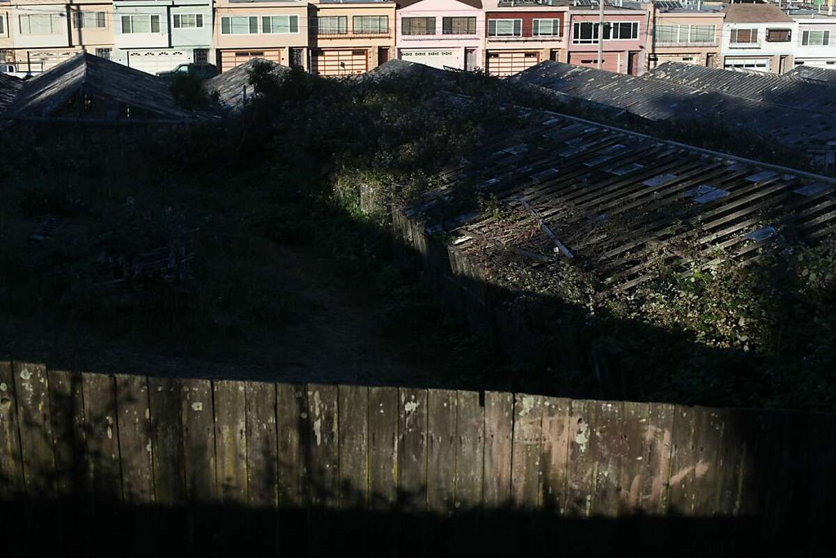 Greenhouses that have fallen into disrepair are seen from Bowdoin Street near the corner of Wayland Street at the bottom of University Mound on June 8, 2013 in San Francisco, Calif.