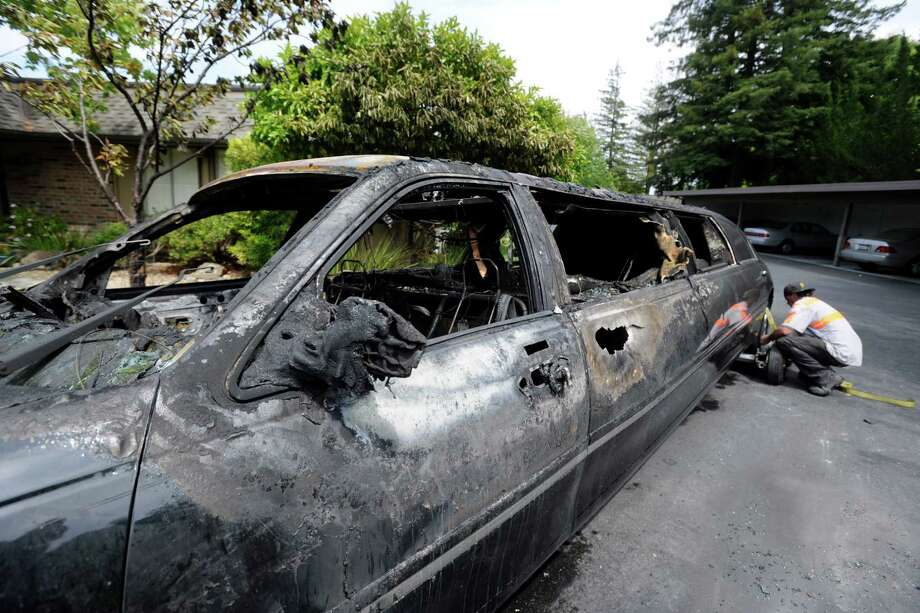 Ten elderly women escaped unharmed just before this limousine burst into flames while idling in Walnut Creek, Calif. Photo: Susan Tripp Pollard, MBR / The Contra Costa Times-Bay Area
