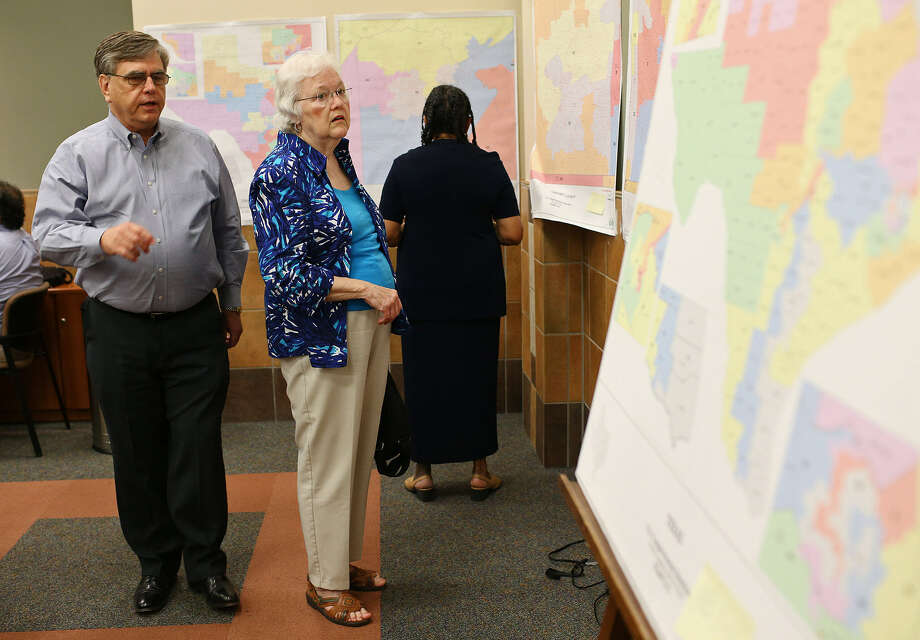 Mike Barrow and Barbara Effenberger of the Guadalupe County Democratic Club look over proposed redistricting maps. Photo: Jerry Lara, San Antonio Express-News