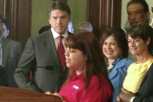 Cristina Salais introduces Gov. Rick Perry as he prepares to sign education reform bills into law. Salais is enrolled in the Alamo Colleges Information Technology Security Academy.