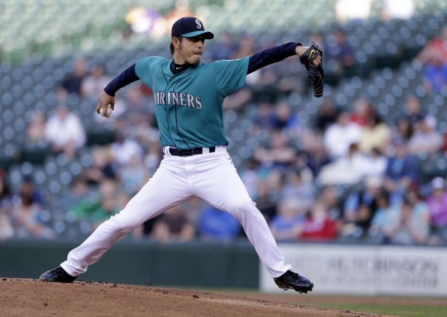 Mariners pitcher Hisashi Iwakuma delivers a throw to the Astros.