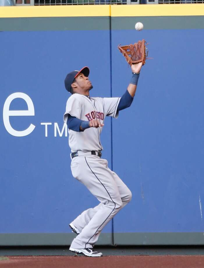 Astros outfielder Jimmy Paredes makes a catch for an out during the first inning against the Mariners.