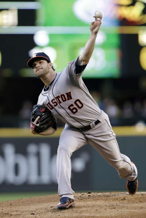 Astros pitcher Dallas Keuchel makes a throw to the Mariners.
