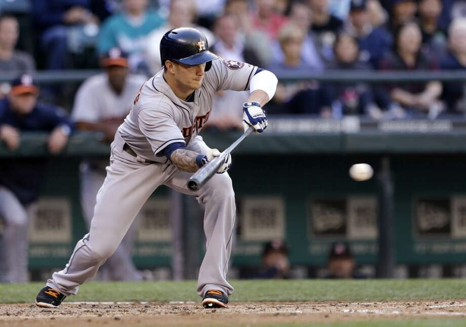 Brandon Barnes of the Astros lays down a bunt against the Mariners.