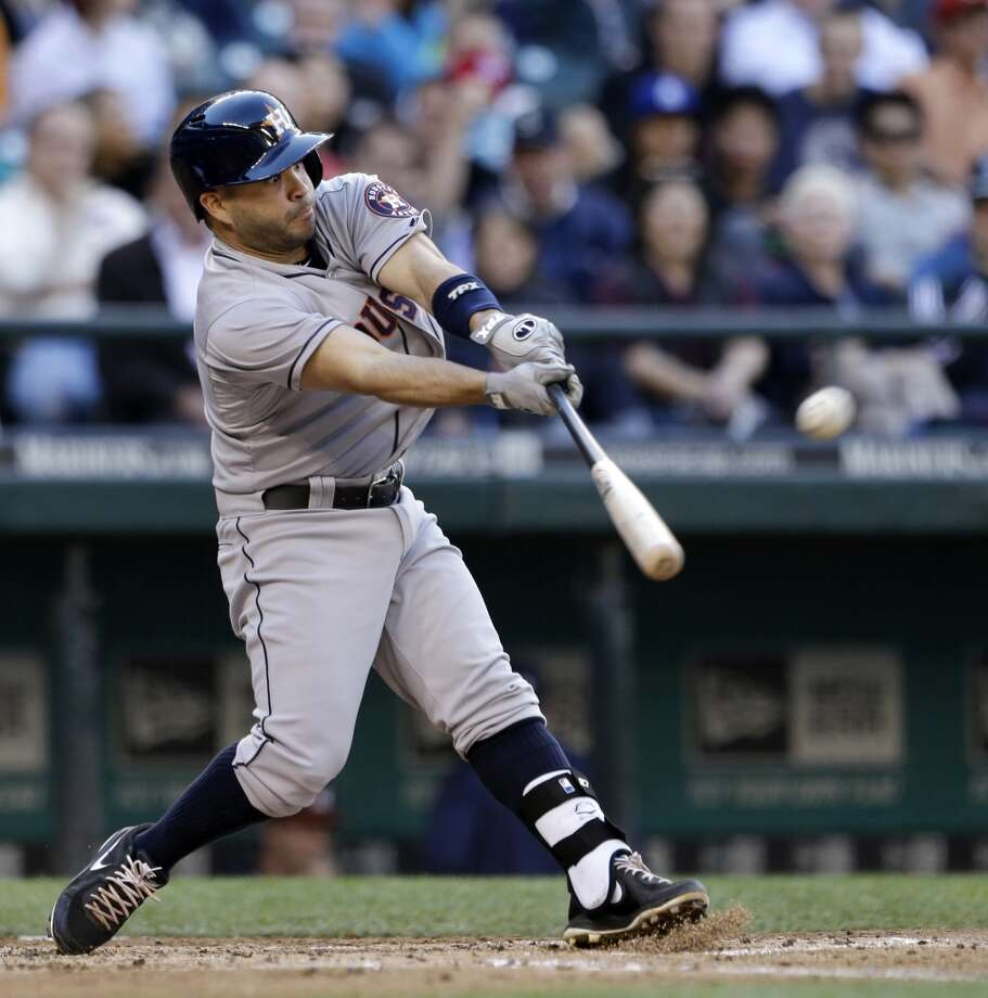 Astros second baseman Jose Altuve hits a sacrifice fly against the Mariners.