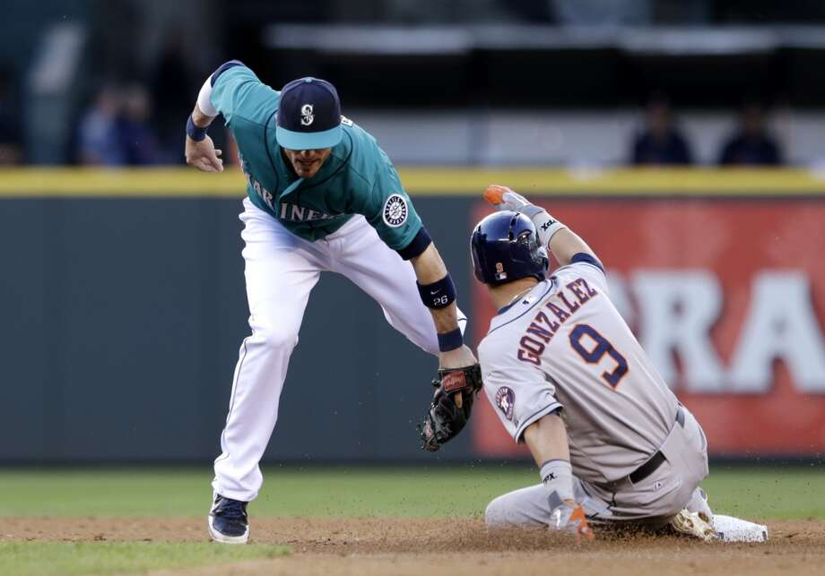 Mariners shortstop Brendan Thompson tries to make a play on Marwin Gonzalez of the Astros at second base.