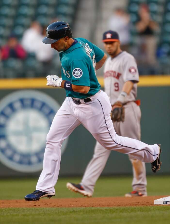 Raul Ibanez of the Mariners rounds the bases after hitting a home run against the Astros during the fourth inning.