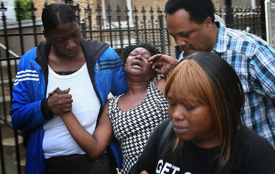 CHICAGO, IL - JUNE 10:  Virginia Jackson (C) breaks down after learning her 18-year-old niece, who had just been shot, was in serious condition on June 10, 2013 in Chicago, Illinois. Her niece, April McDaniel, was shot along with 4 other people while they were hanging out on a porch on the city's Southside. The five were among at least 12 people reported to have been shot today in Chicago. April died at the hospital from her wounds.  (Photo by Scott Olson/Getty Images) Photo: Scott Olson, Getty Images