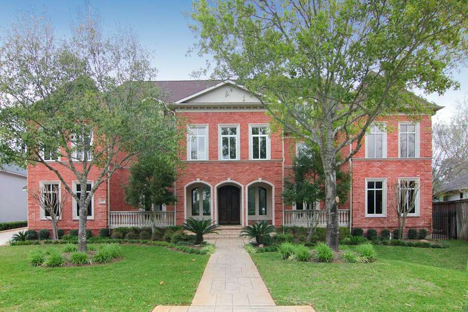This large, custom home is located in a private gated complex in the Energy Corridor. Photo: Martha Turner Properties