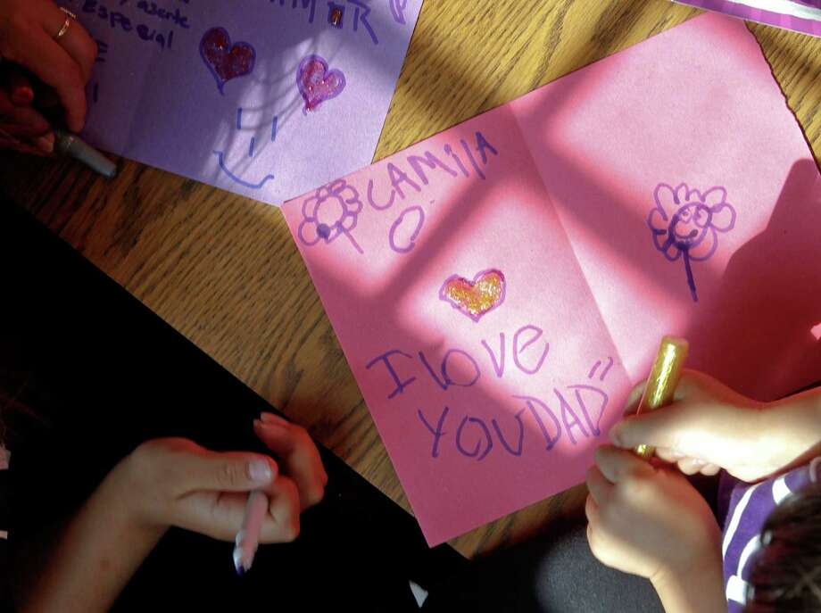 Hand-made or store-bought, a card expressing gratitude is all dad really needs on Sunday. Photo: Michael Macor, File Photo / SFC