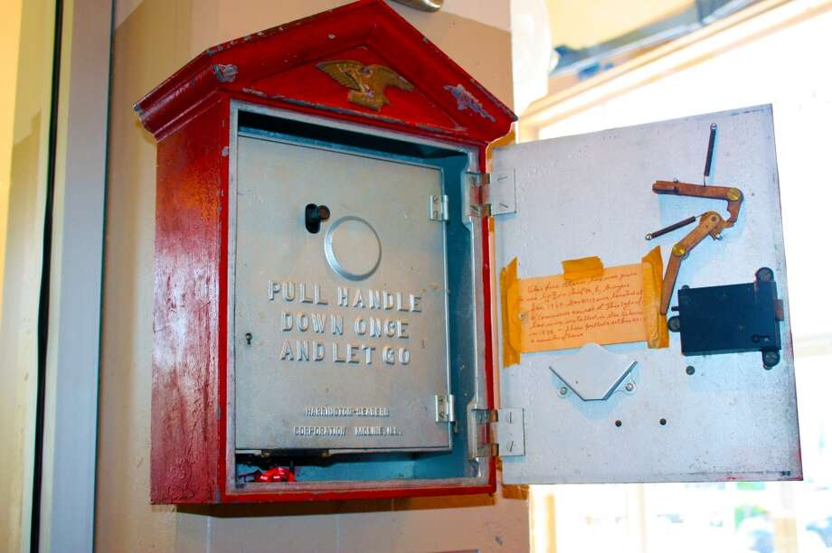 Fire stations have used different forms of communication throughout the years. A telegraph box, used to receive fire alerts, hangs on a wall at the museum. Photo: Emily Bamforth , Express-News