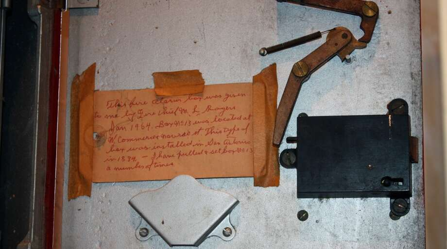 A placard inside the telegraph box explains the piece's history. Photo: Emily Bamforth, Express-News