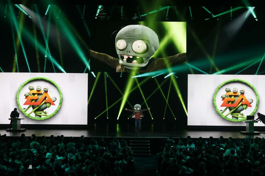 "John Vechey, co-founder and vice president of corporate strategy and development at PopCap Games, arrives on stage to talk about the company's game ""Plants vs Zombies: Garden Warfare"" during the Electronic Arts Inc. E3 media event in Los Angeles, California, U.S., on Monday, June 10, 2013. Developers are looking for the first new consoles in almost seven years to pull the video-game industry out of a two-year slump in retail sales."