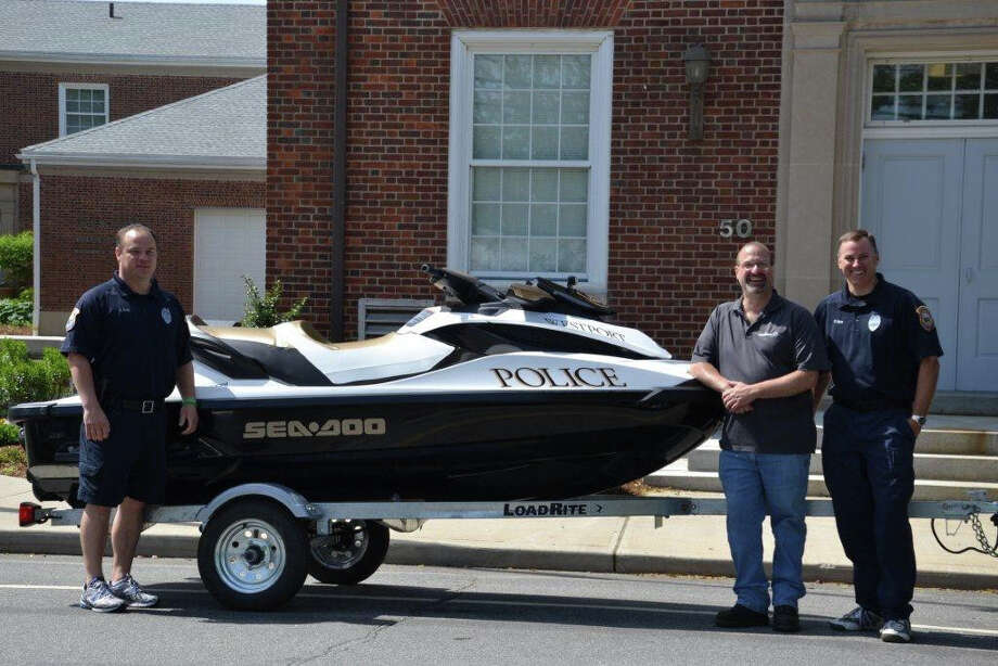 Robert Gargano (middle), owner GSS Powersports, is flanked by Westport Marine Officers Kevin Smith (left) and Robert Myers (right). Gargano is loaning a Sea-Doo watercraft to the police department for the 2013 boating season. Photo: Contributed Photo