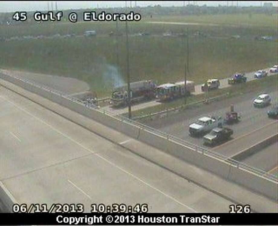 At least one person died in a traffic crash on the frontage road of the northbound Gulf Freeway near El Dorado late Tuesday morning. Photo: Houston Transtar