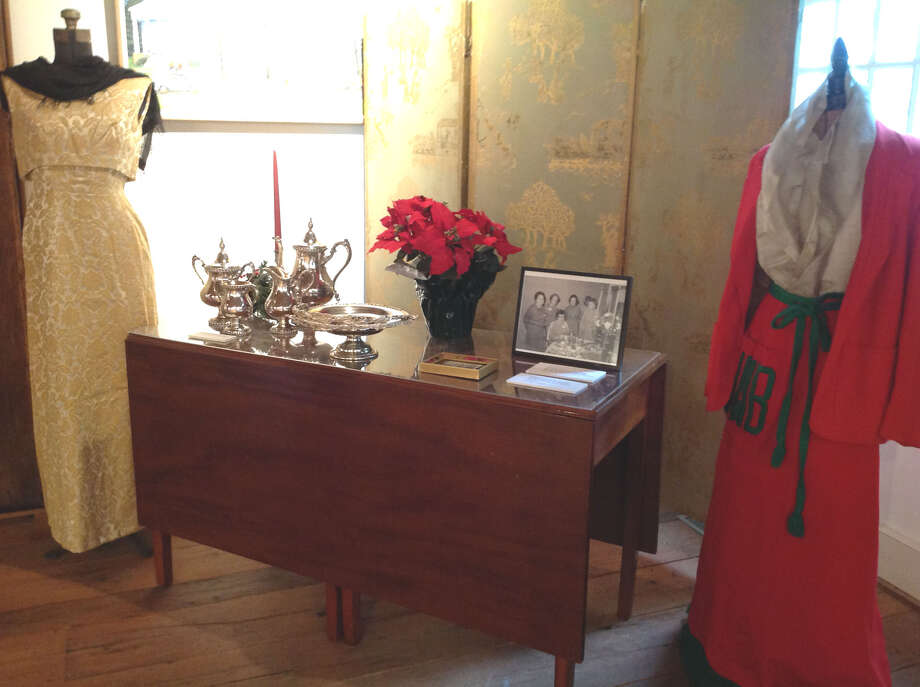 ëArt in Bloomí  ìArt in Bloom,î an exhibit celebrating the 90th anniversary of the New Milford Garden Club, is on display at the New Milford Historical Society, 6 Aspetuck Ave., through July. Above is a tea service and clothing belonging to a past president of the club.  Courtesy of the New Milford Historical Society Photo: Contributed Photo