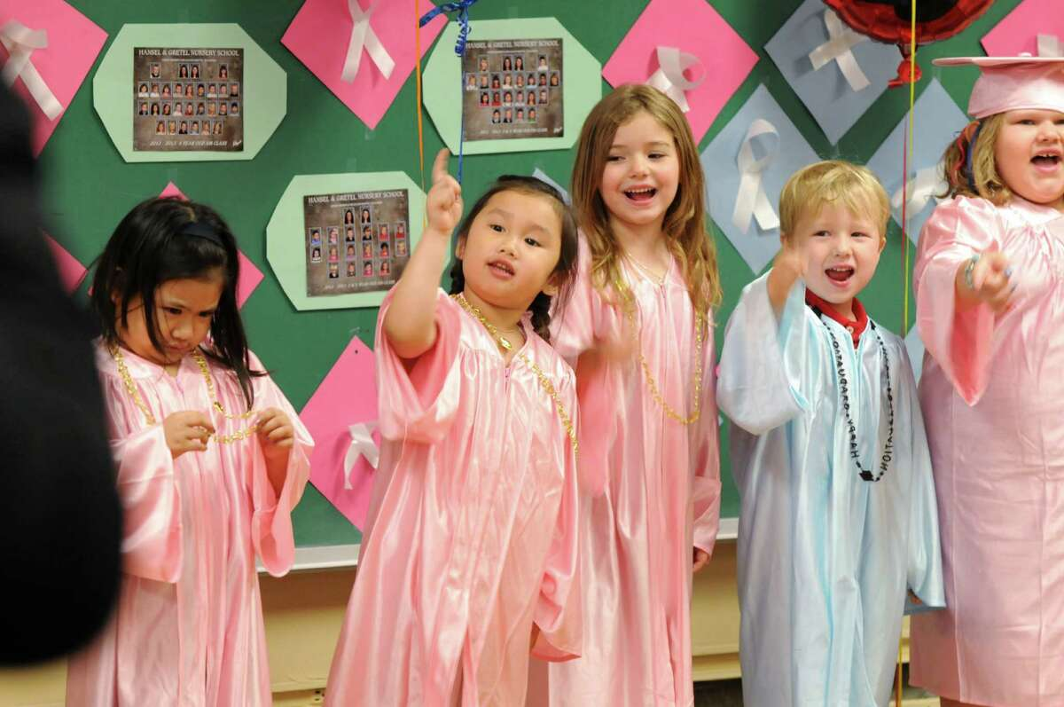 Three and four-year-old students at Hansel and Gretel Nursery School perform during a graduation ceremony Friday June 7, 2013, in Loudonville, N.Y. The nursery is celebrating 40 years of business. (Will Waldron/Times Union)
